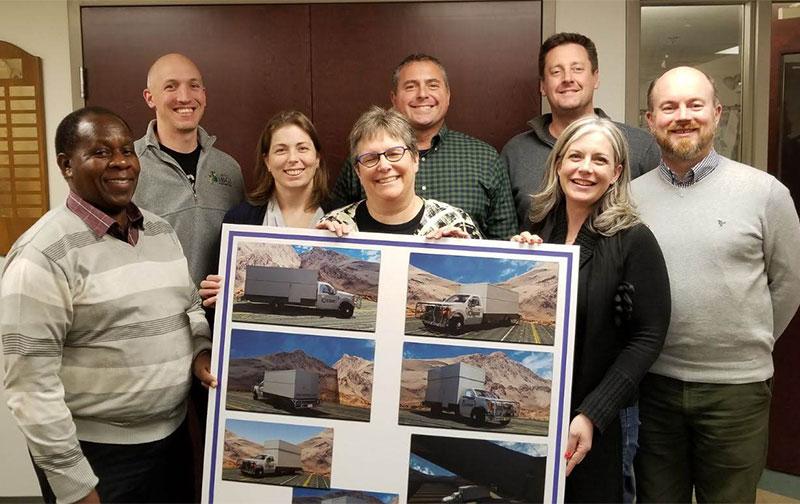Integrum Scientific team with Mobile Lab vehicle photos